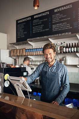 Buy stock photo Portrait of a young waiter working on a till in a cafe