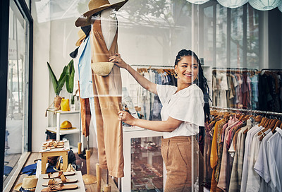 Buy stock photo Cropped shot of a young woman working in a clothing store