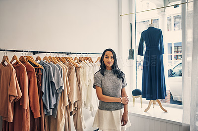Buy stock photo Cropped shot of a young business owner standing in her store