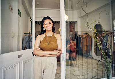 Buy stock photo Shot of a boutique owner standing in the doorway to her shop