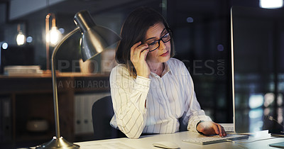 Buy stock photo Cropped shot of an attractive young businesswoman suffering with a headache while working late in a modern office