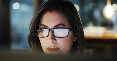 Buy stock photo Closeup shot of an attractive young businesswoman working late in a modern office