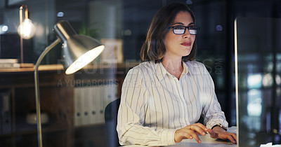 Buy stock photo Cropped shot of an attractive young businesswoman working on a computer in a modern office at night