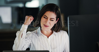 Buy stock photo Cropped shot of an attractive young businesswoman cheering while working late in a modern office