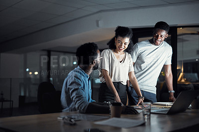 Buy stock photo Cropped shot of three confident young designers having a discussion together while working late at night in their office