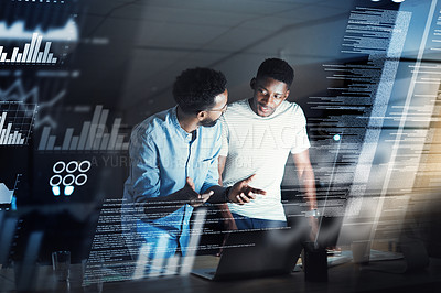 Buy stock photo Cropped shot of two young male programmers working together late at night in their office