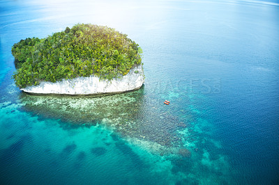 Buy stock photo High angle shot of two adventurous young couples canoeing together in the beautiful oceans of Indonesia