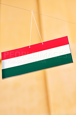 Buy stock photo Shot of the flag of Hungary hanging outside a tourist attraction in Vietnam