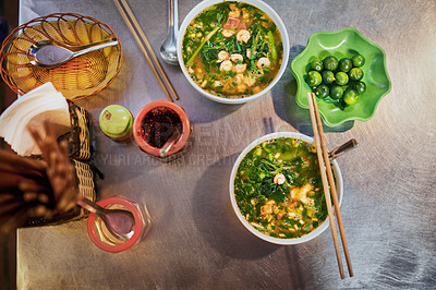 Buy stock photo Shot of a bowl of prawn noodle soup in a Vietnamese restaurant