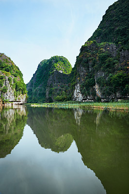 Buy stock photo Shot of a river flowing through a mountainous region in Vietnam
