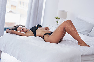 Buy stock photo Full length portrait of a gorgeous young woman posing in lingerie on her bed at home