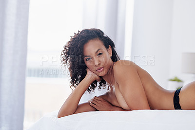 Buy stock photo Cropped portrait of a gorgeous young woman posing topless on her bed at home