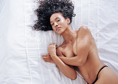 Buy stock photo High angle portrait of a gorgeous young woman posing topless on her bed at home