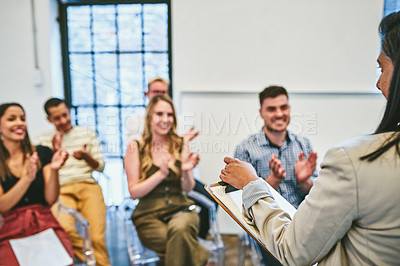 Buy stock photo Cropped shot of an unrecognizable businesswoman receiving a round of applause from her colleagues during a seminar