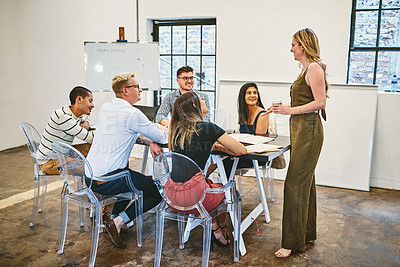 Buy stock photo Full length shot of a diverse group of businesspeople having a seminar in a modern office