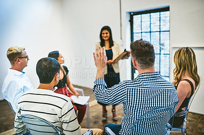 Buy stock photo Cropped shot of an unrecognizable businessman raising his hand to ask a question during a seminar