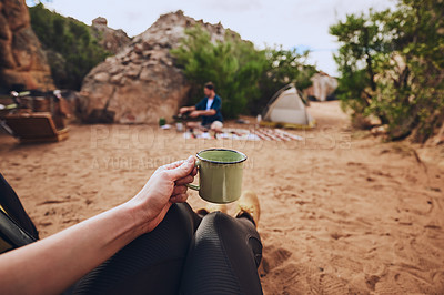 Buy stock photo Shot of an unrecognisable woman drinking coffee while camping in the wilderness
