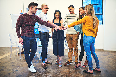 Buy stock photo Shot of a group of businesspeople joining their hands in solidarity in a modern office