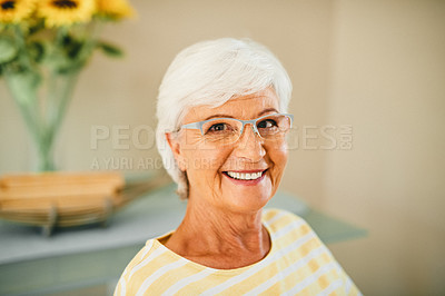 Buy stock photo Cropped shot of a senior woman sitting at home