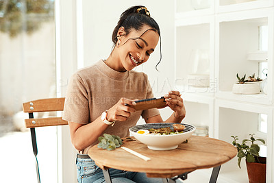 Buy stock photo Cropped shot of an attractive young businesswoman using her cellphone to take pictures of her lunch for her blog