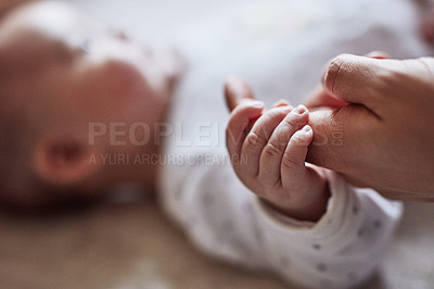 Buy stock photo Cropped shot of a father playing with his infant daughter