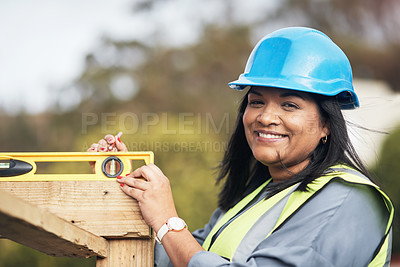 Buy stock photo Cropped portrait of an attractive young female construction worker working on site