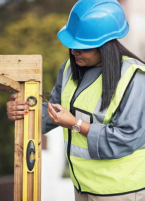 Buy stock photo Cropped shot of an attractive young female construction worker working on site