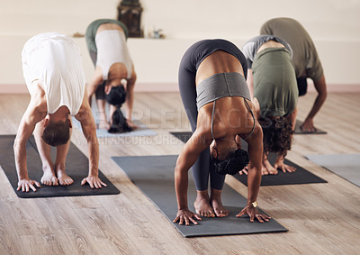 Buy stock photo Full length shot of a group of young  people working out together in a yoga class
