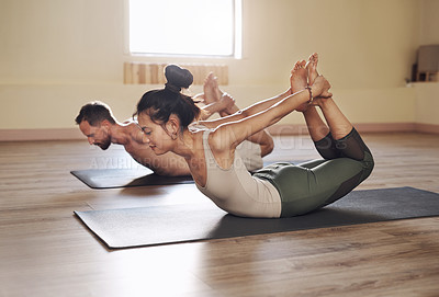 Buy stock photo Full length shot of two young people working out together in a yoga class