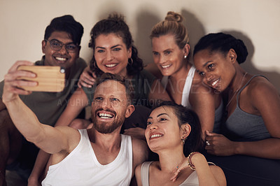 Buy stock photo Shot of a group of young people taking selfies after working out together in a yoga class