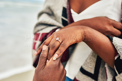 Buy stock photo Closeup shot of a man proposing to his girlfriend at the beach