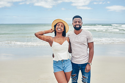 Buy stock photo Portrait of a young couple spending some time together at the beach