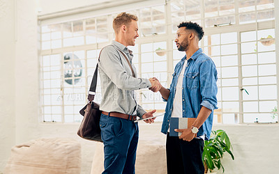 Buy stock photo Cropped shot of two handsome young businessmen standing together and shaking hands before having a meeting