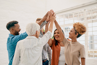 Buy stock photo Cropped shot of a diverse group of businesspeople standing together and raising their hands for a group high five