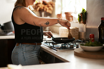 Buy stock photo Cropped shot of a woman preparing a meal at home