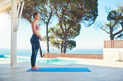 Buy stock photo Shot of a young female athlete practising yoga at home