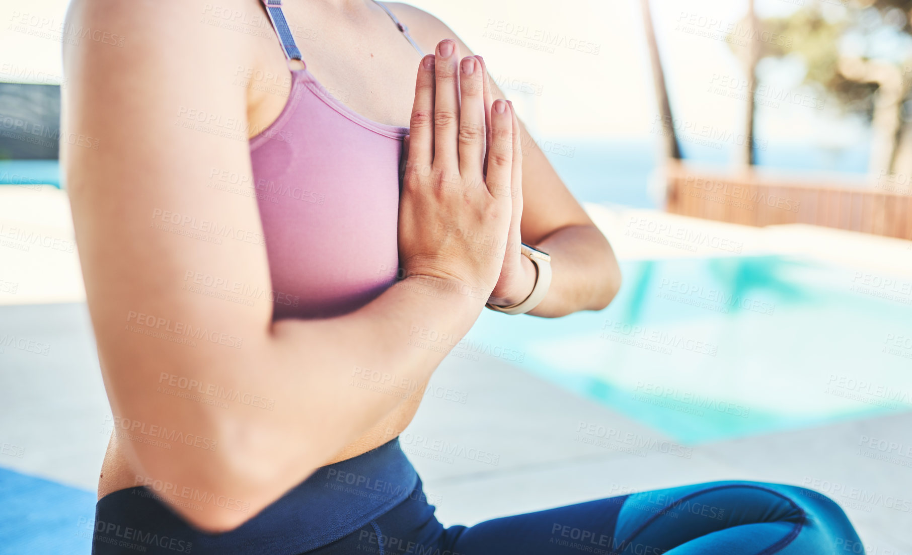 Buy stock photo Cropped shot of an unrecognizable woman practicing yoga outdoors