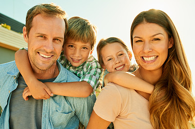 Buy stock photo Cropped shot of a happy family of four having fun outdoors