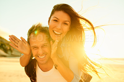 Buy stock photo Cropped shot of an affectionate couple spending the day at the beach