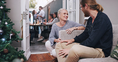 Buy stock photo Shot of a young man and woman chatting at a dinner party with their friends