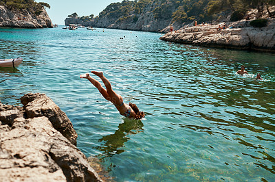 Buy stock photo Shot of an unrecognizable woman diving into a lake outdoors in Spain