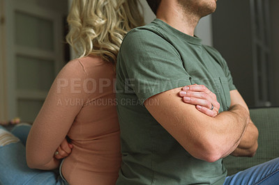 Buy stock photo Cropped shot of a young couple having a disagreement at home