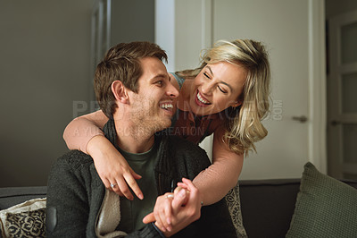 Buy stock photo Shot of a young couple spending quality time at home