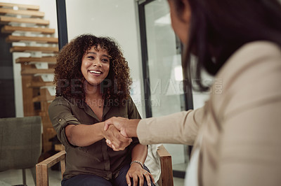 Buy stock photo Shot of a young businesswoman shaking hands with a colleague in an office