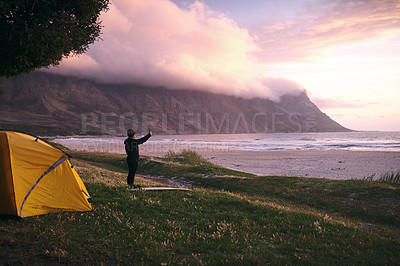 Buy stock photo Shot of an attractive young woman camping at her favourite surfing spot
