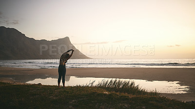 Buy stock photo Full length shot of an unrecognizable woman standing alone and stretching after a yoga session outdoors