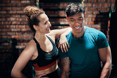 Buy stock photo Cropped shot of two young sportspeople standing together in a gym