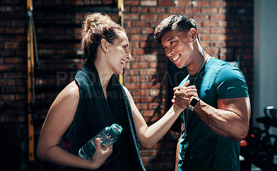 Buy stock photo Cropped shot of two cheerful young sportspeople cheering while working out in a gym