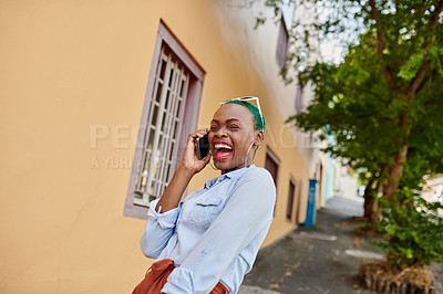 Buy stock photo Cropped shot of an attractive young woman talking on her cellphone outside during the day