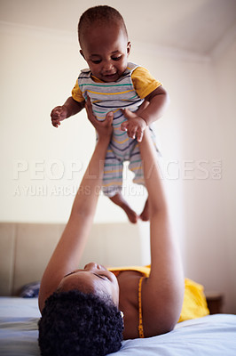 Buy stock photo Shot of an adorable little boy spending quality time with his mother at home